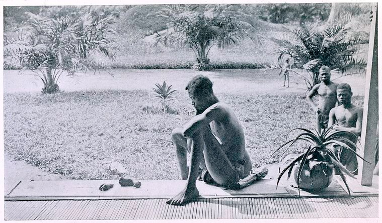 Nsala_of_wala_in_congo_looks_at_the_severed_hand_and_foot_of_his_five-year_old_daughter__1904