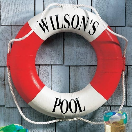 Life preserver personalized with 'WILSON'S POOL' written around it, hanging on display