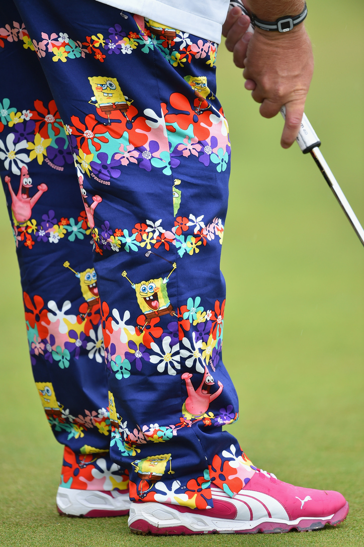 john daly is at the british open  wearing pants with busty