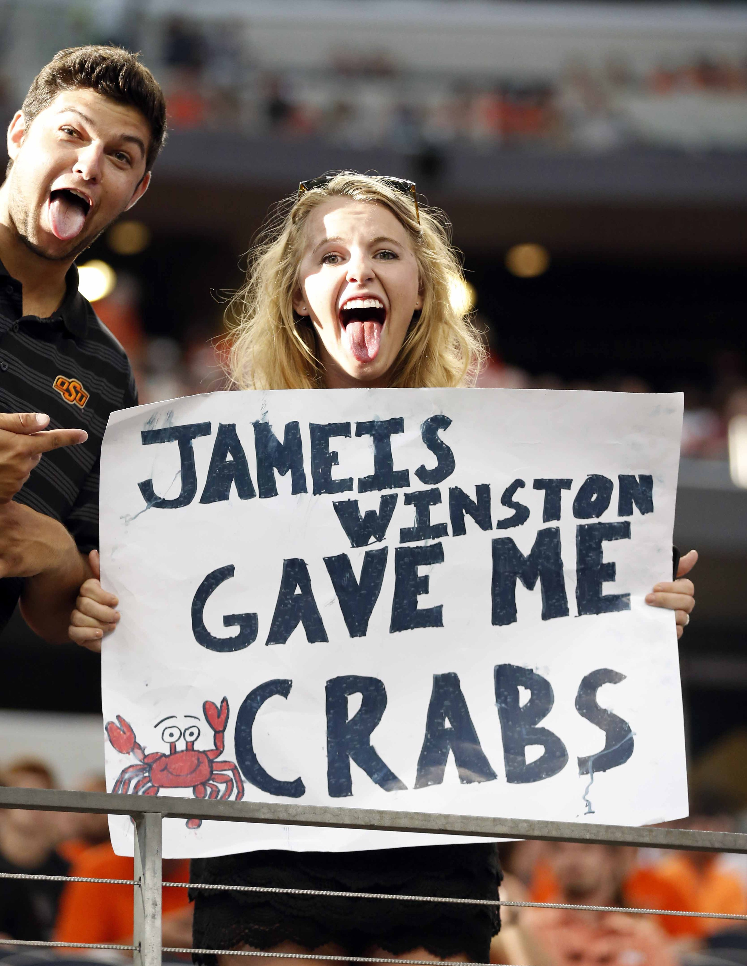 More than a dozen Jameis Winston crab legs signs at 'College ...