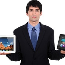 Man-holding-ipad-and-surface-370x229