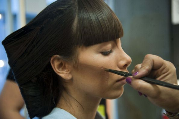 A model has makeup applied during Fashion Week (RAUL ARBOLEDA/AFP/Getty Images)
