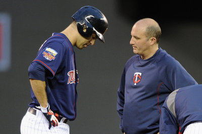 Twins place Joe Mauer on disabled list, call up Chris Colabello