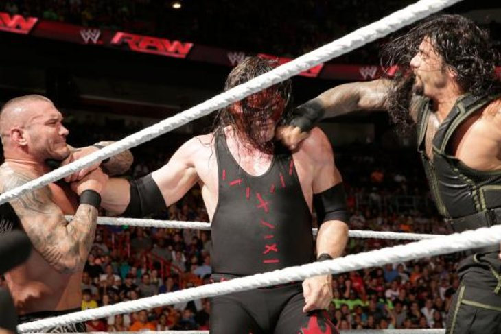 GIF: Roman Reigns superman punch hits Kane so hard Randy Orton feels ...