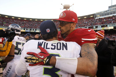 Sports Illustrated cover features Colin Kaepernick, Russell Wilson for NFL preview