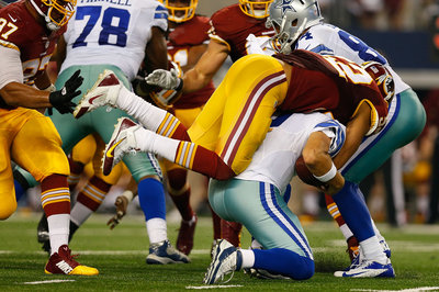 Could Tony Romo Miss Time With Back Injury?