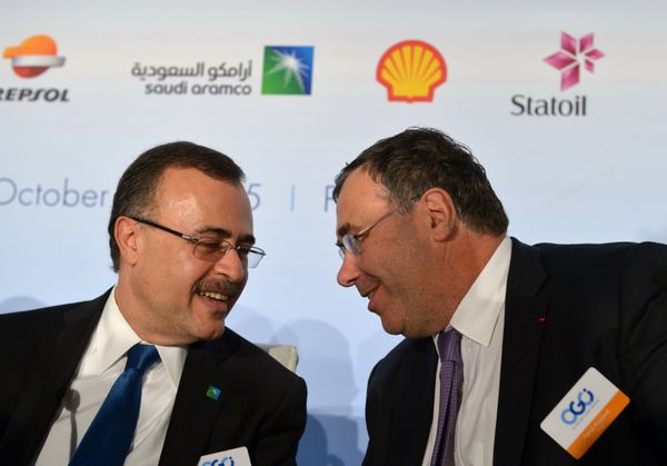 Saudi Aramco CEO Amin Nasser (L) talks with Total CEO Patrick Pouyanne this past October.