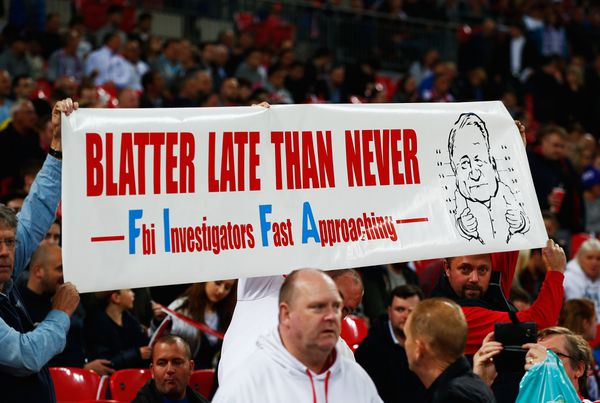 Fans hold a banner protesting against Sepp Blatter prior to the UEFA EURO 2016 Group E qualifying match between England and Estonia.