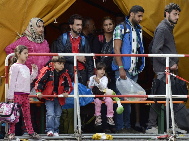 Refugees waiting for bus