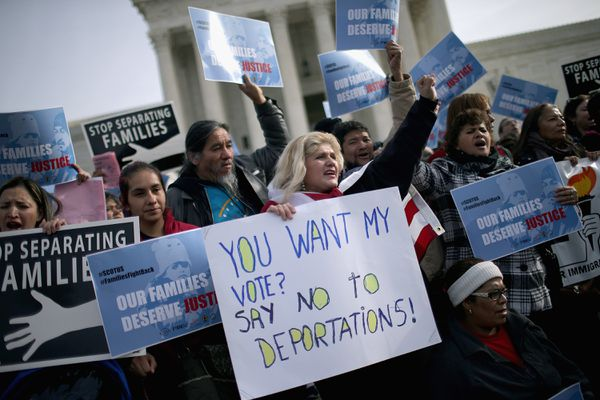 About fifty demonstrators support Obama's actions rally outside the United States Supreme Court on January 15, 2016.