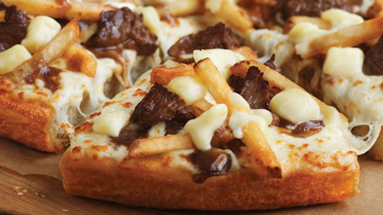 Pizza Hut Canada Unleashes the Cheesy Beef Poutine Pizza - Eater