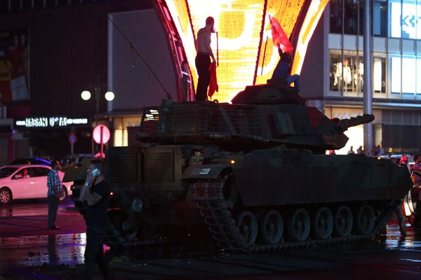A protester on a tank in the middle of the street in Ankara.