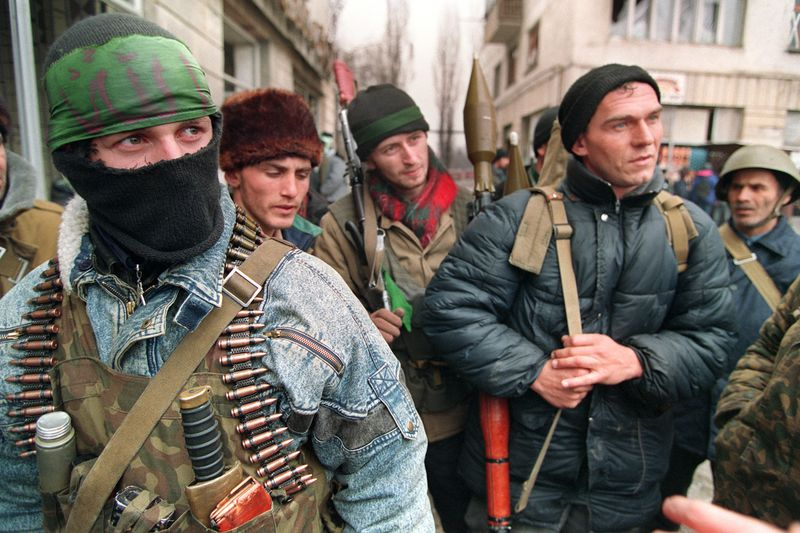 Chechen independence fighters gather in Grozny in 1995, during the First Chechen War (MICHAEL EVSTAFIEV/AFP/Getty)