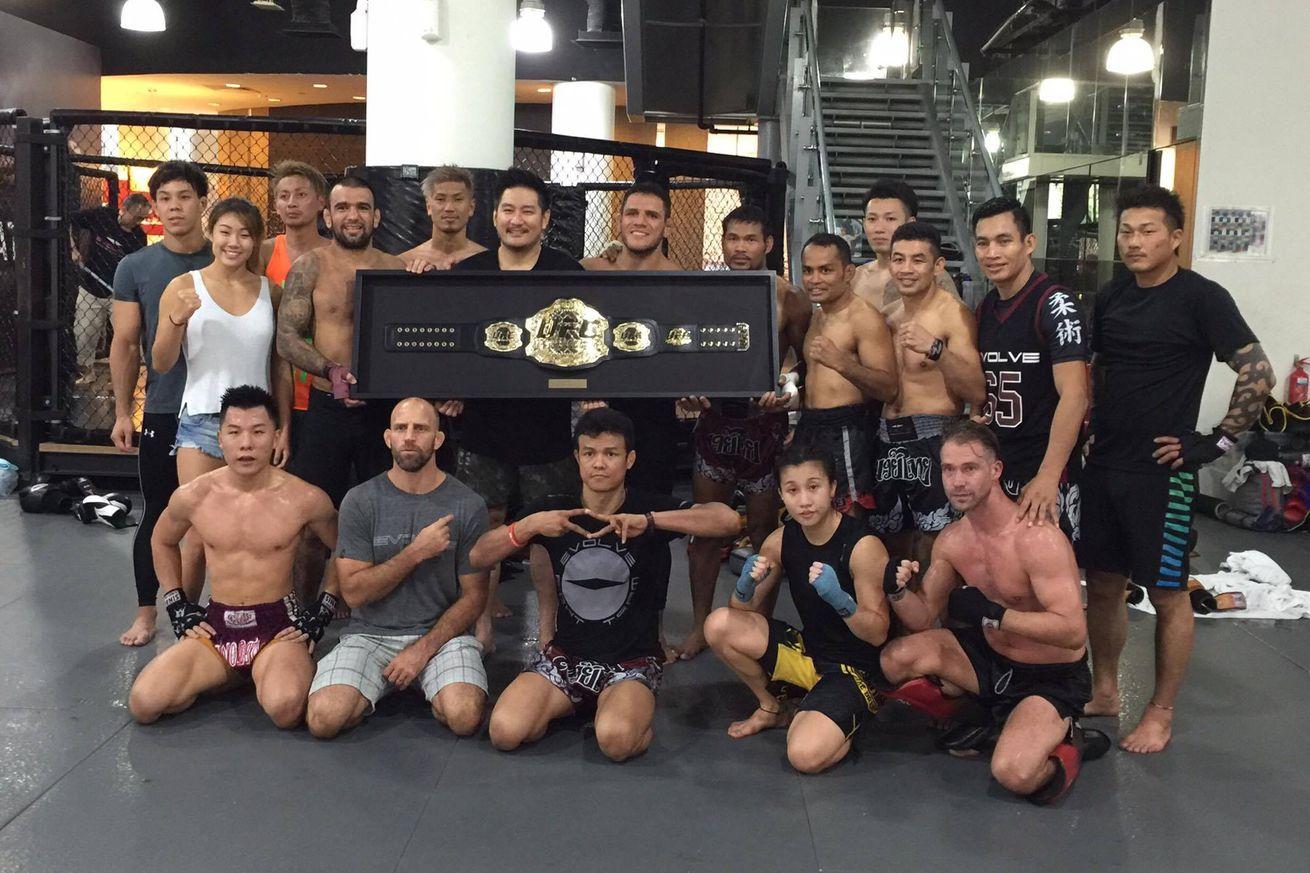 Rafael dos Anjos gifts UFC lightweight belt to Chatri Sityodtong in Singapore
