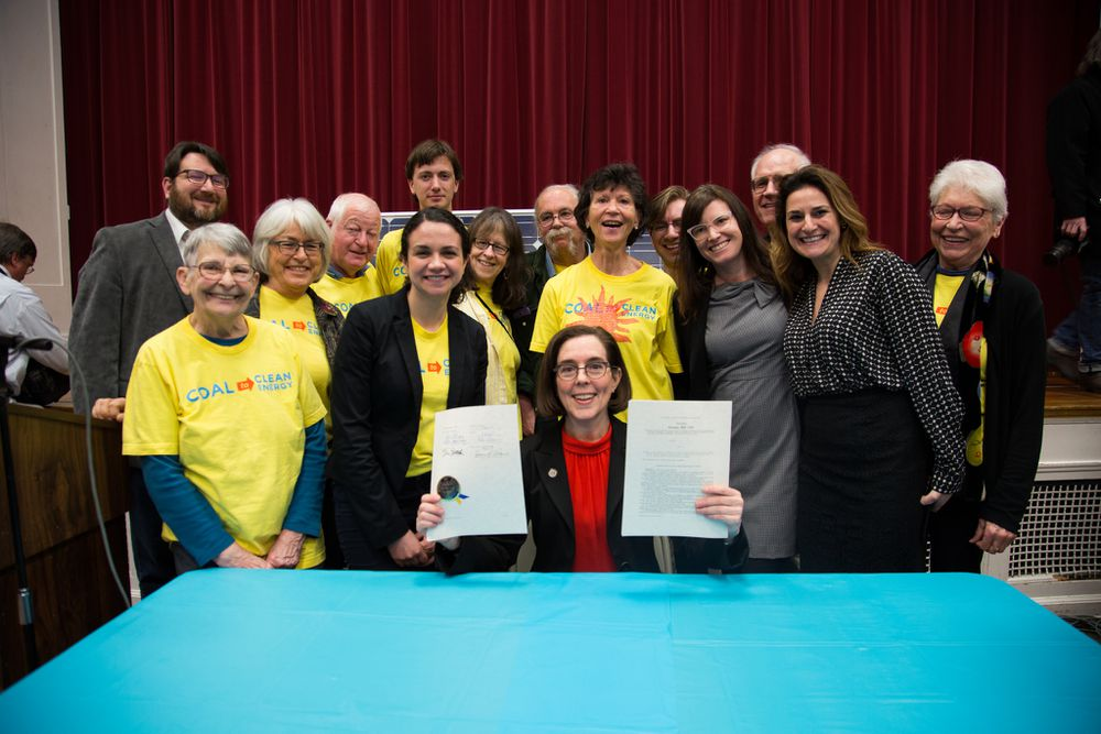 Oregon Gov. Kate Brown, with her newly signed energy bill.
