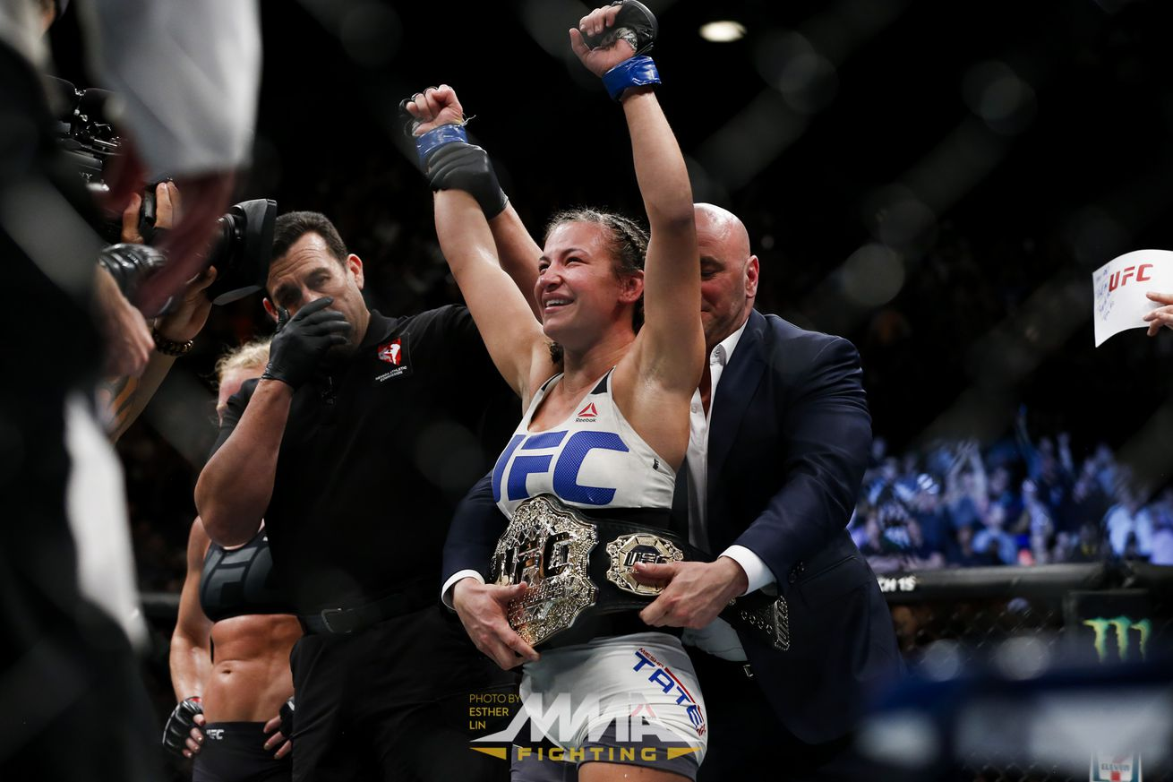 community news, UFC 196 results: Miesha Tate stuns Holly Holm with fifth round submission