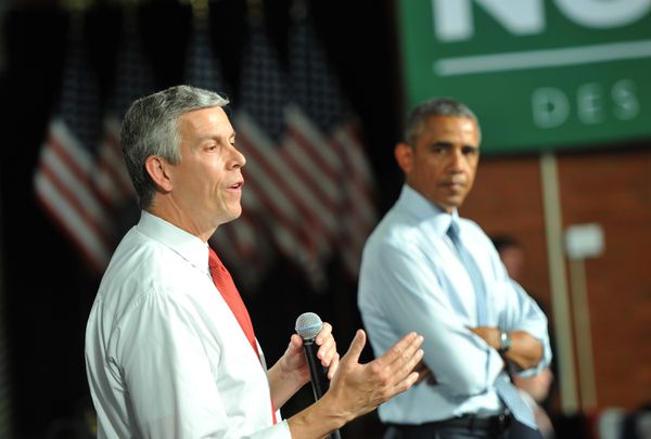 Secretary of Education Arne Duncan speaks alongside Barack Obama attend a town hall at North High School on September 14, 2015 in Des Moines, Iowa.