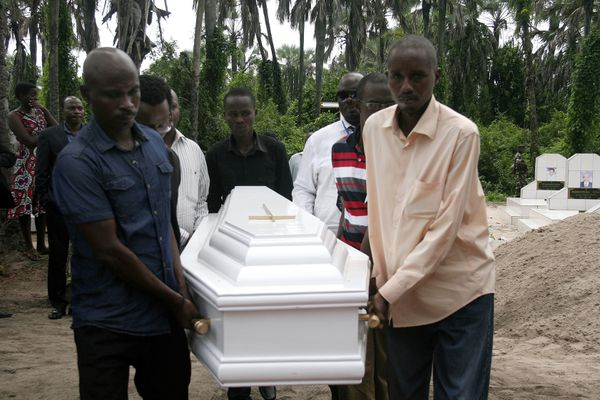 Pall-bearers carry the coffin of Welly Nzitonda, the son of human rights defender Pierre-Claver Mbonimpa, during a funeral ceremony in Bujumbura, Burundi