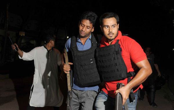 An injured police officer in Dhaka following the attack.