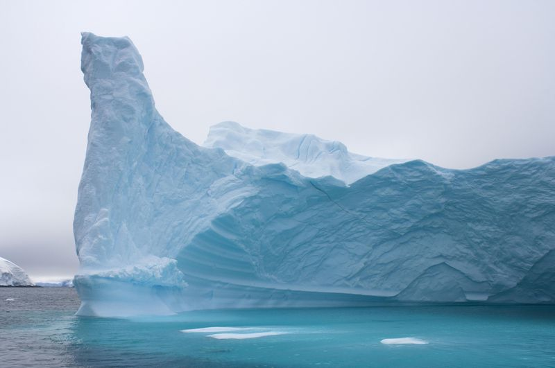 Iceberg floating off the western Antarctic peninsula, Antarctica, Southern Ocean. (Steven Kazlowski / Barcroft Media / Getty Images)