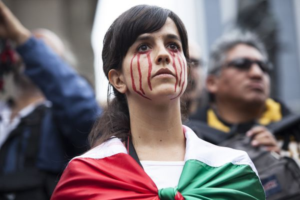 A protester at a September 2015 rally in Mexico City for the missing students.