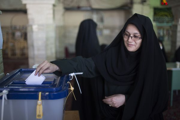 An Iranian woman votes in parliamentary and Expert Assembly elections in Qom.