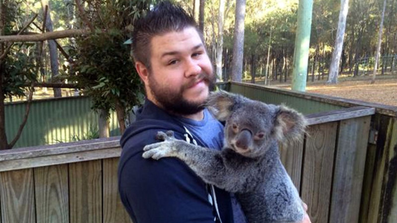 Pic kevin owens with a koala in australia cageside seats