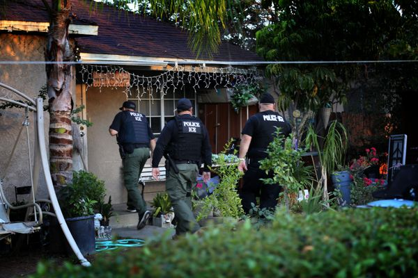 ICE officers conduct a raid in Riverside, California.