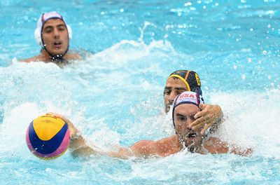 John Mann of the USA competes for the ball against Marc Minguell Alferez of Spain.