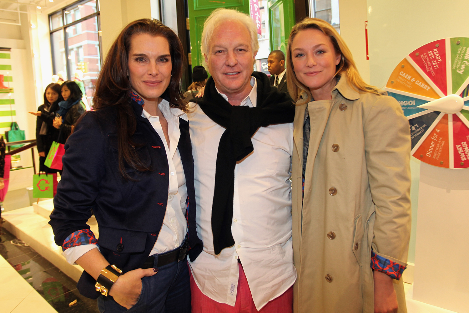 01127b73c3dc Burch flanked by Brooke Shields and Elisabeth Rohm at C. Wonder s grand  opening event. Photo  Getty Images