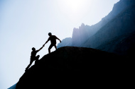 stock-photo-26359060-two-climbers-reaching-the-top-of-a-mountain.0.jpg