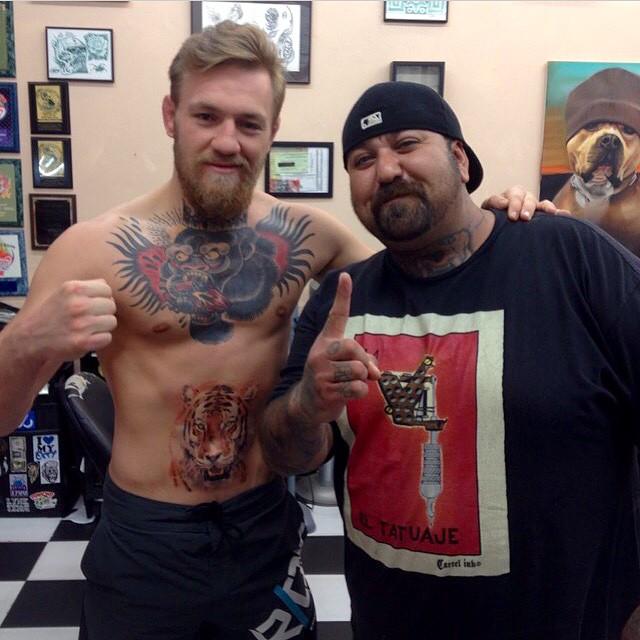 Photos: Conor McGregor gets a tiger tattoo over his