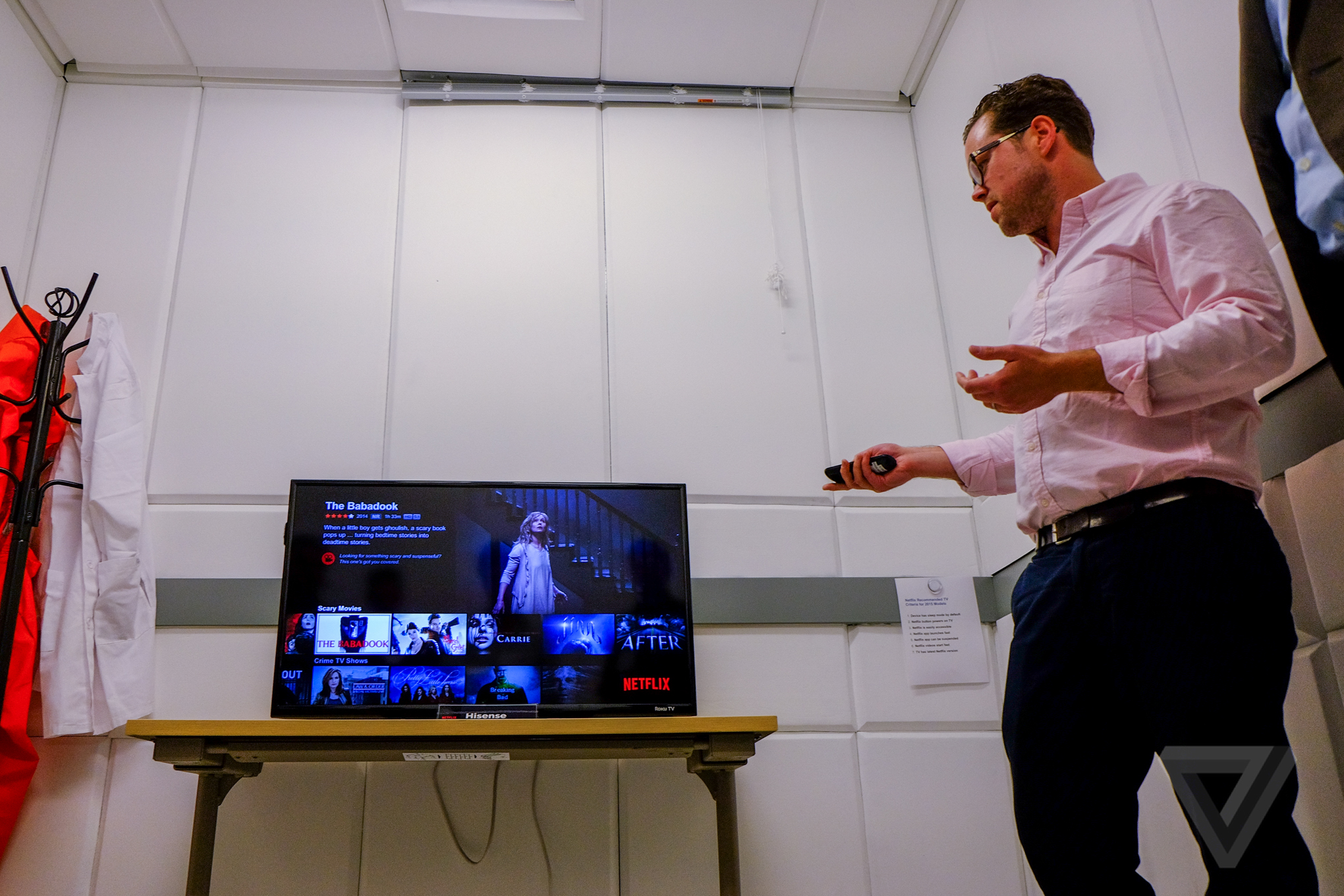Gunderson demos the latest Roku TV as an example of a lower-end TV that still meets its recommendation standards.
