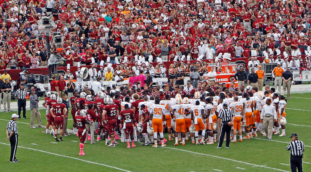 Players from both teams surround Lattimore after injury