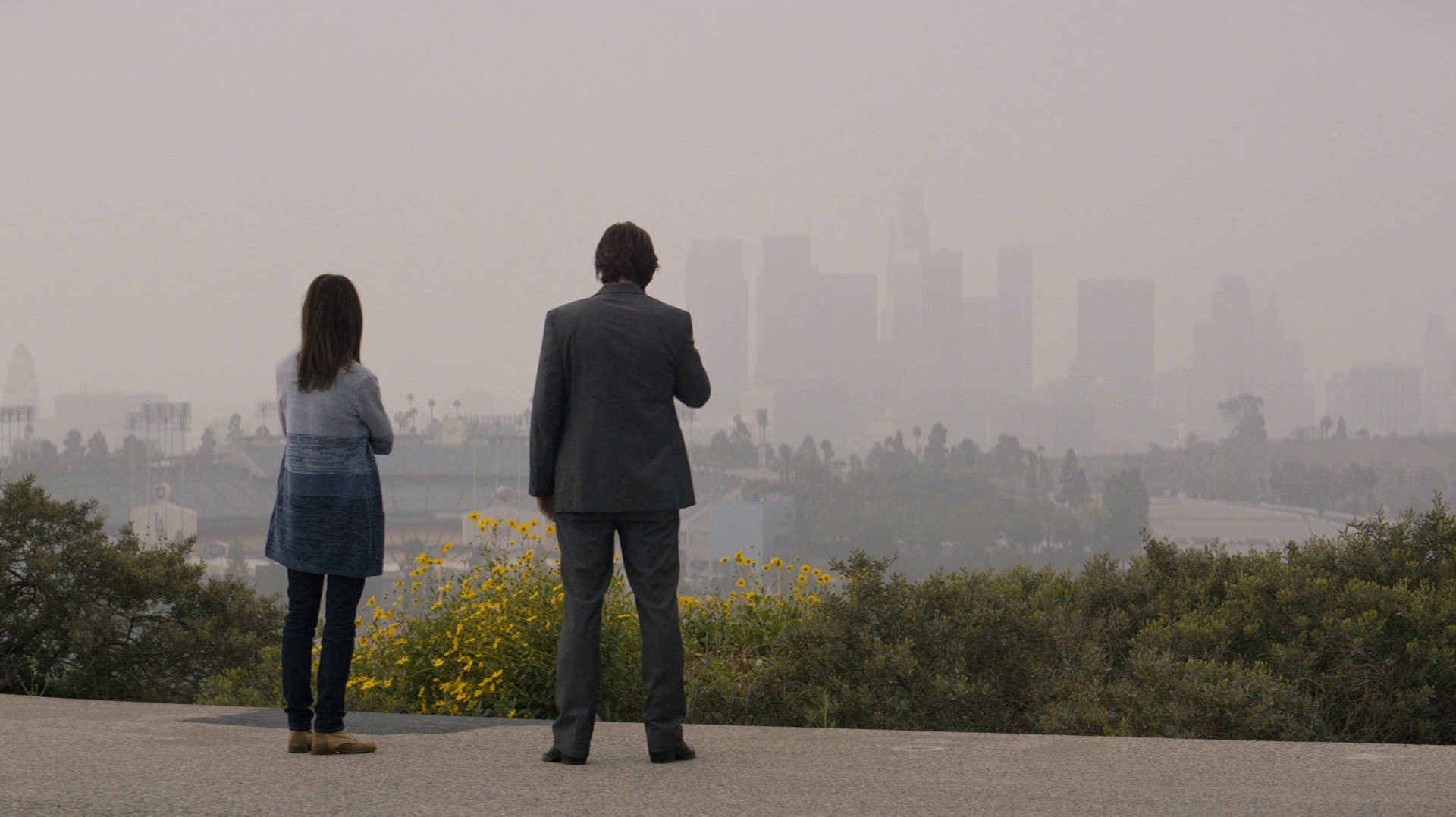 Gena and Ray overlooking smoggy downtown Los Angeles