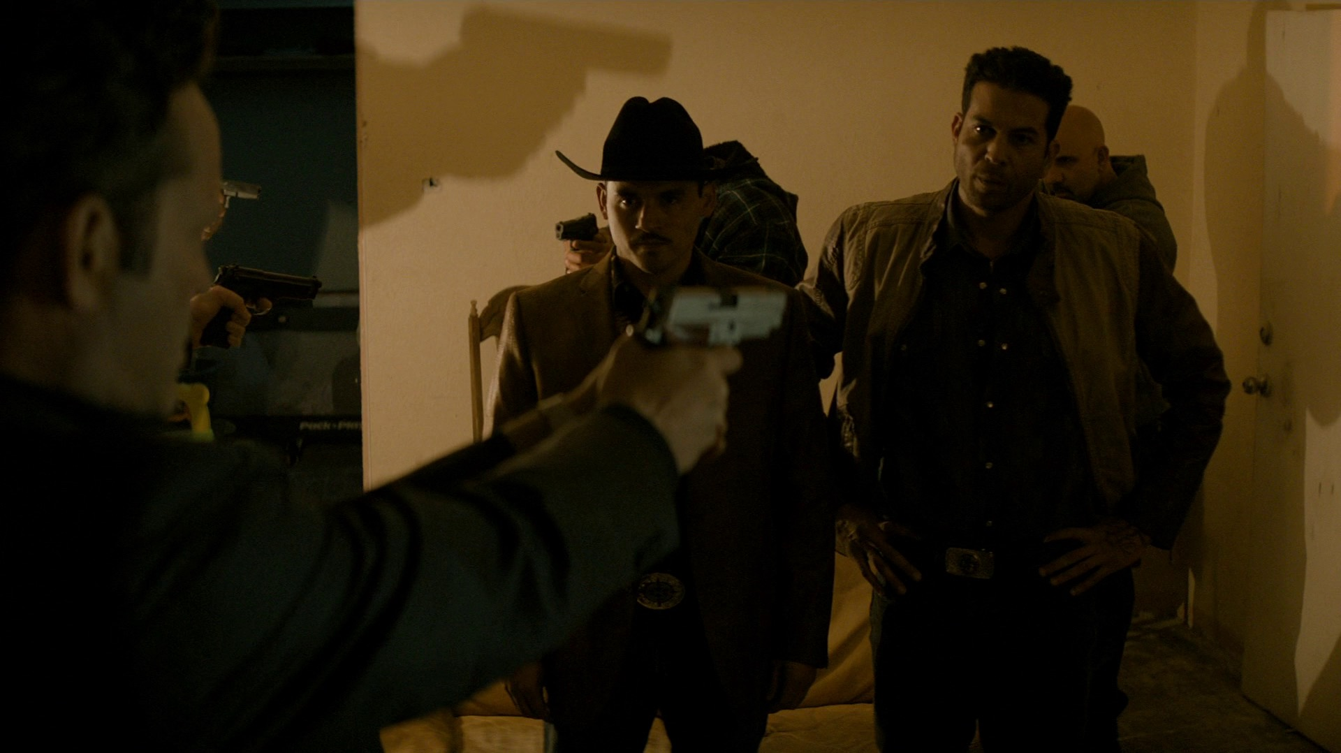 Frank and the Mexican thugs who tried to twist his arm in the previous episode