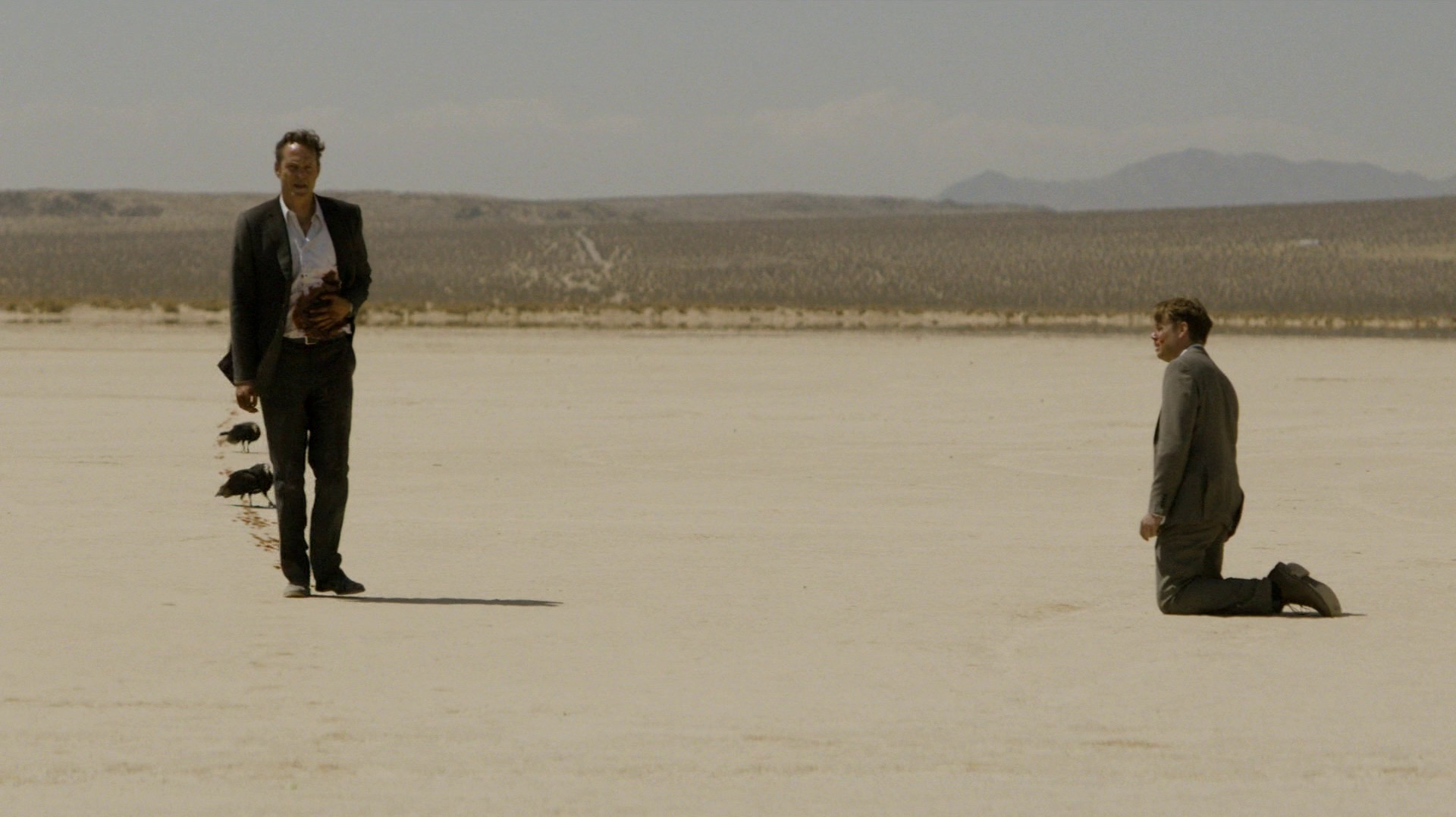 Frank walks by the man in the suit