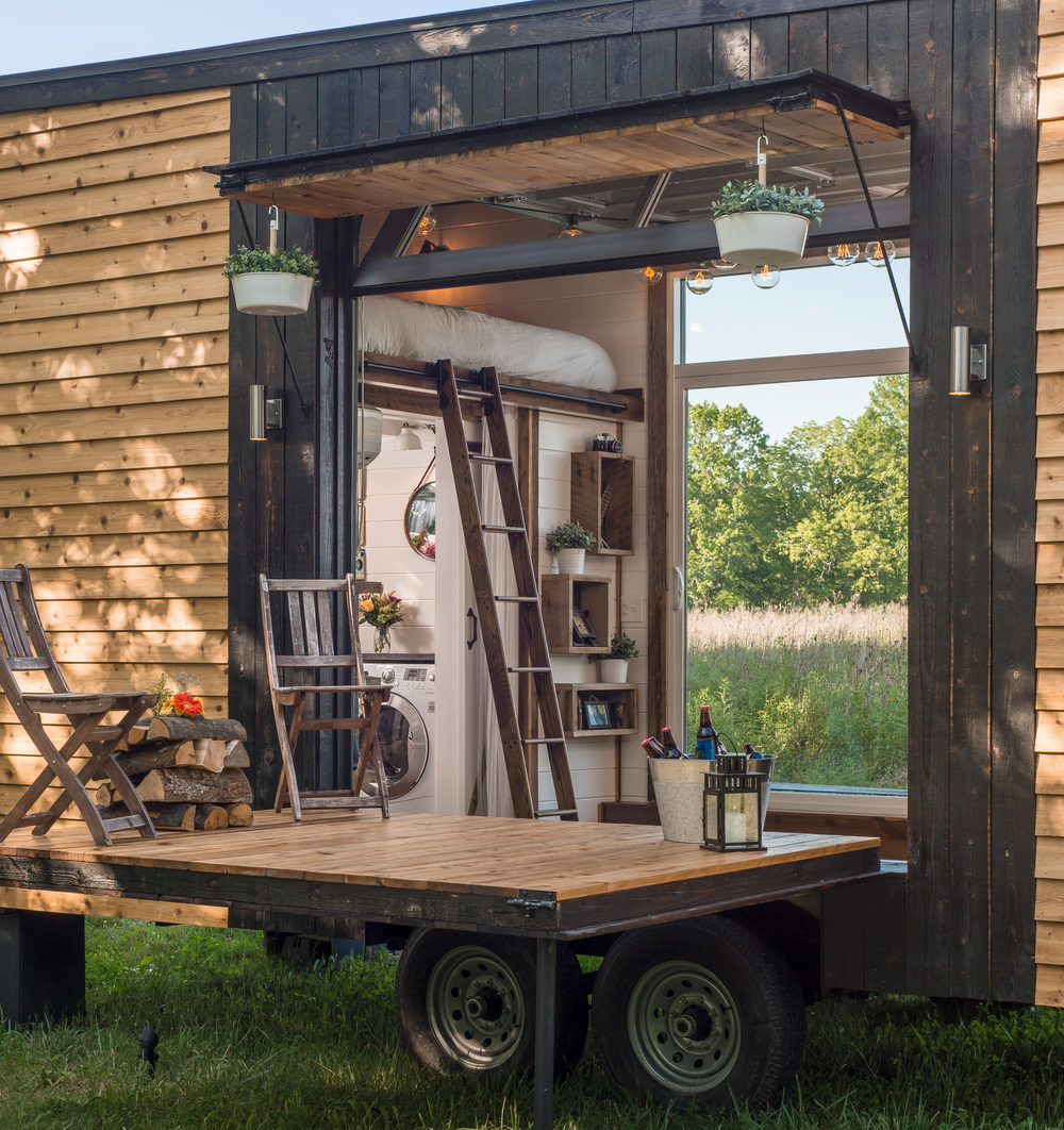 Enjoyable Tricked Out Tiny Home Features Garage Door And Custom Deck Curbed Largest Home Design Picture Inspirations Pitcheantrous