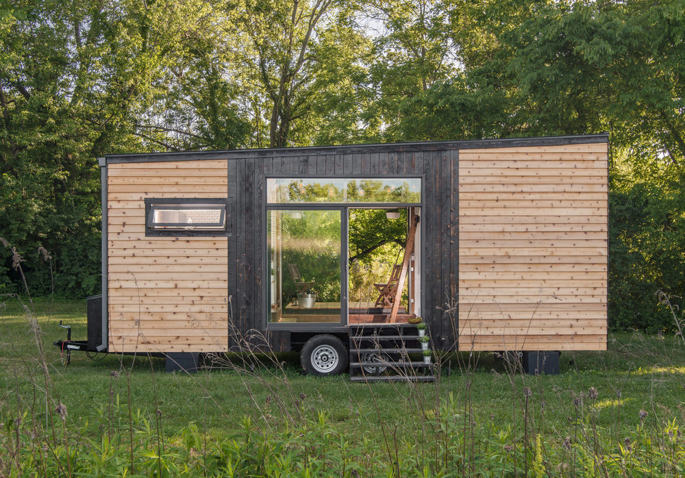 Tricked Out Tiny Home Features Garage Door And Custom Deck