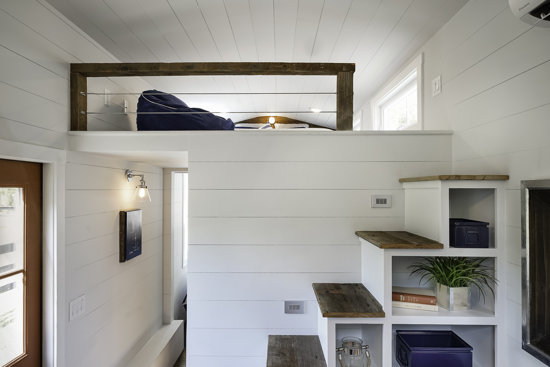 Currently available for 69500 the 280 square foot indigo tiny house from driftwood homes usa allows lovers a bit of privacy with a separate bedroom