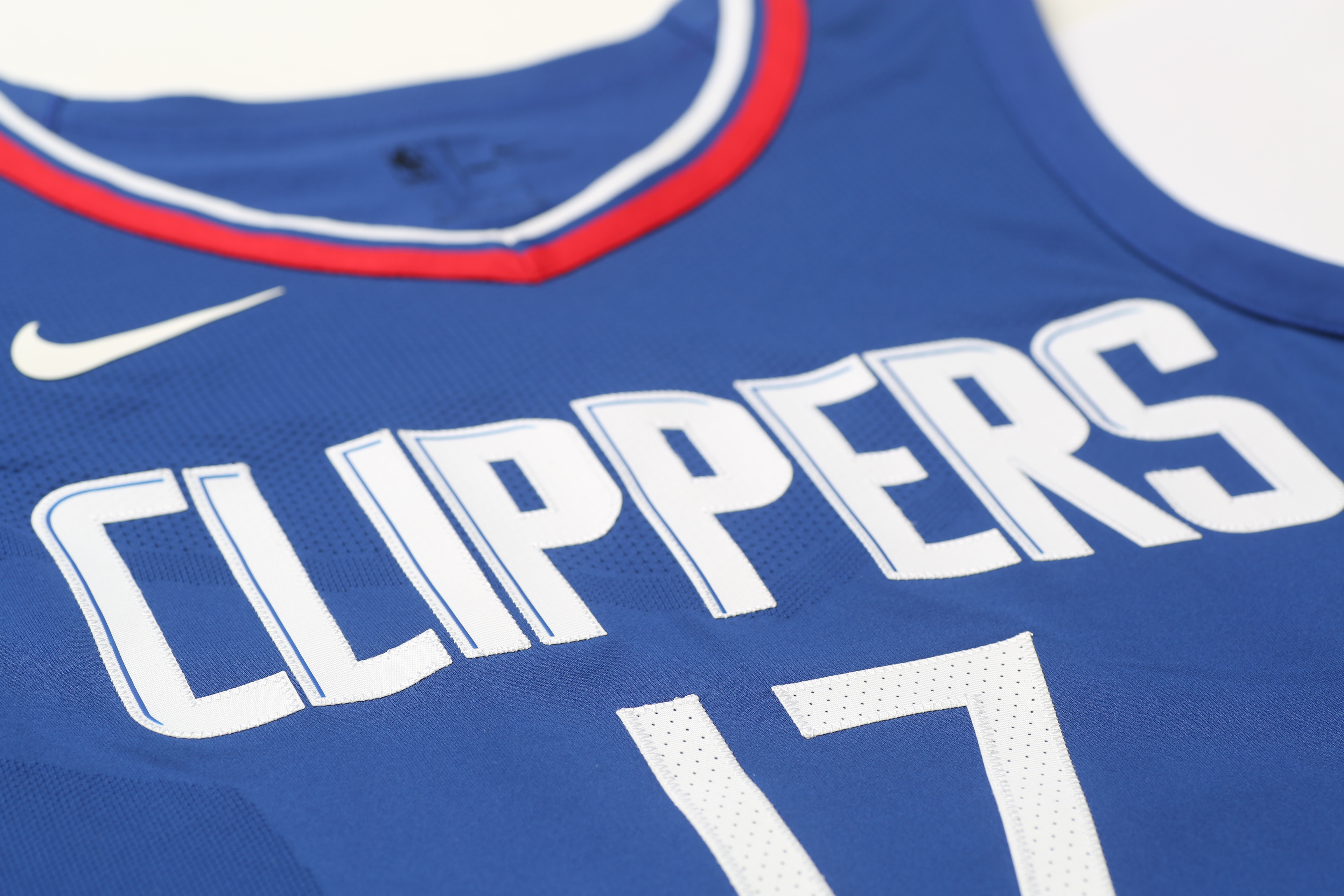 "252132d8 View of the ""Clippers"" wordmark on the team's new blue ""Icon edition"" jersey  designed by Nike. The previous lines underneath the wordmark have been  removed."