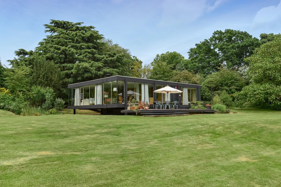 Midcentury modern curbed for Modern glass house for sale